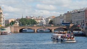 Anichkov Bridge and tour ships on the Fontanka river in the summer Royalty Free Stock Photography
