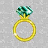 Anillo de oro con la esmeralda Imágenes de archivo libres de regalías