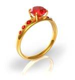 Anillo de oro con las joyas rojas Imagen de archivo