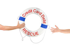 Anillo y manos de la boya de vida del rescate de la deuda de la tarjeta de crédito Imagenes de archivo