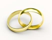 Anillos de bodas de oro en el fondo blanco Imágenes de archivo libres de regalías