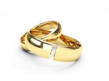 Anillos de bodas quebrados del oro Fotografía de archivo