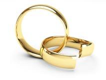 Anillos de bodas quebrados del oro Imagen de archivo libre de regalías