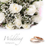 Anillos de bodas y rosas Fotografía de archivo libre de regalías