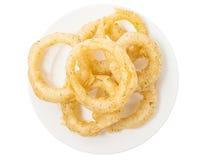 Anillos de cebolla curruscantes fritos en la placa blanca Imagen de archivo libre de regalías