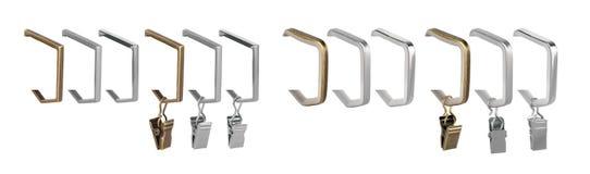 Anillos de cortina para los aleros Anillos del metal con los clips para las cornisas Imágenes de archivo libres de regalías