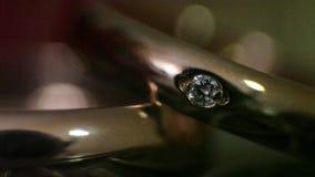 Anillos de diamante en luz metrajes