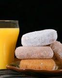 Anillos de espuma y zumo de naranja Foto de archivo