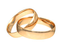Anillos de oro de la boda en blanco Imagen de archivo libre de regalías