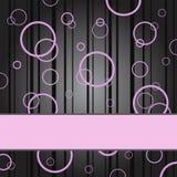 Anillos rosados en un fondo negro Fotos de archivo