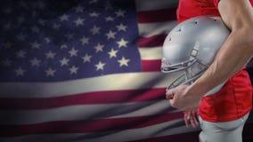 Animación de Digitaces del jugador del rugbi con la situación del casco contra bandera americana almacen de metraje de vídeo