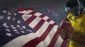 Animación de Digitaces del jugador del rugbi que celebra la bola de rugbi frente a bandera americana almacen de video