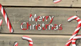 Animación del caramelo del partido contra fondo de madera con deseo de la Feliz Navidad almacen de video
