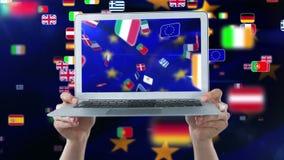 Animación europea de las banderas en la pantalla del ordenador portátil almacen de video