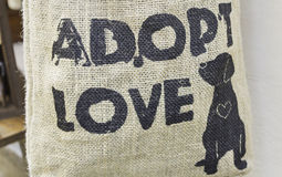 Animal Adoption. Sign on wicker background, love and nature Stock Photography