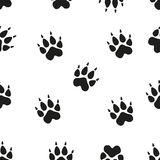 Animal - birds and mammals footprints silhouettes set  on white background. Animal footprint seamless pattern. Paw. Vector seamless pattern with paw footprints Royalty Free Stock Photography