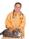 Animal Care. A young girl looking after her pet cat as he sits on a small table Royalty Free Stock Photography