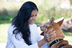 Animal care. Closeup portrait, sweet moments healthcare professional in white lab coat with dog,  sunny outdoors outside background, green trees Royalty Free Stock Images