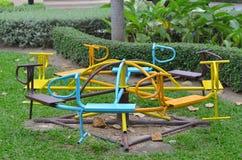 Animal carouse. Eight iron carousel on playground Royalty Free Stock Images