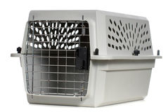 Animal Carrier. A grey cat carrier with the door closed, isolated against a white background Stock Photo