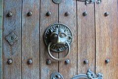 Animal door knocker. Gothic door knocker from a medieval castle. Lion look alike Stock Images