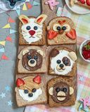 Animal faces toasts with spreads, banana, strawberry and blueberry. Funny animal faces toasts with spreads, banana, strawberry and blueberry stock photo