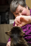 Animal facilitated therapy for a mentally disabled woman Stock Photos