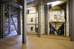 Animal feed factory. New industrial interior of empty warehouse. With machines royalty free stock photos