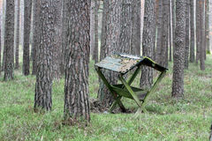 Animal feeding shelter. In the forest Stock Photos
