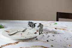 Animal Figurines On Messy Table Stock Photo