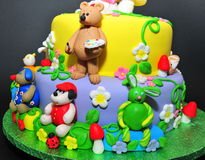 Animal fondant figurines - cake details. Beautifully crafted cake with little animals fondant figurines Stock Image