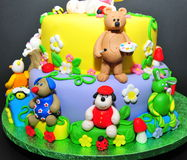 Animal fondant figurines - cake details. Beautifully crafted cake with little animals fondant figurines Stock Photos