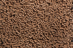 Animal food pellets. Background texture Stock Image