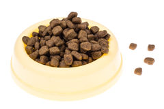 Animal food in special bowl on white background stock photos