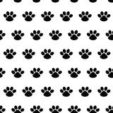 Animal footprint. Seamless  pattern with traces of dogs on white. Background. Cute endless template for 2018 year. Paw Stock Image