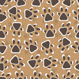 Animal footprint seamless pattern. Animal footprint seamless pattern witj brown background Royalty Free Stock Photos