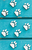 Animal footprint sign. On wooden Stock Images