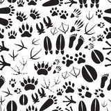 Animal footprints black and white seamless pattern Royalty Free Stock Images