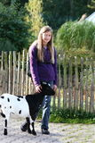 Animal Friend. Blond young girl feeding the animals Royalty Free Stock Photography