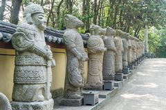 Animal god or mythology creature stone sculptures in Chinese culture. Text under each statues mean what animals are they royalty free stock images