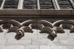 Animal heads on the facade of a church. White marble animal heads on the facade of a church Royalty Free Stock Photography