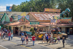 Animal Kingdom Theme Park, Dinsey World. Crowds enjoy the Animal Kingdom Theme Park at Disney World in Orlando Florida. Visible are attractions in the DinoLand Stock Photography