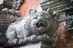 Animal like a dog on the wall of temple. Bali Royalty Free Stock Image