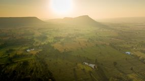 Animal livestock Farm housing in rural ranch. Surfaces on Livestock house, land and Cattle Farm in rural in Thailand with sunrise, fog and mountain background royalty free stock photography