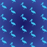 Animal pattern: pelicans of blue color in profile. Birds on dark blue background. Stylish youthful bright print. Animal pattern: pelicans of blue color in Royalty Free Stock Image