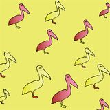 Animal pattern: yellow and pink silhouette of pelican in profile, standing on one leg. Birds on a yellow background. Stylish youthful bright print Stock Images
