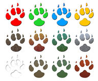 Animal paw print. A set of 12 paw prints in various colors and patterns isolated on white Royalty Free Stock Images