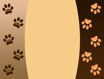 Animal paw prints on brown background. stock images