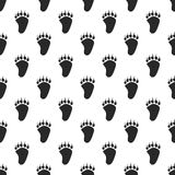 Animal paw seamless pattern. Bear black paw Stock Images