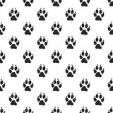 Animal paw seamless pattern. Wolf black paw Royalty Free Stock Photos